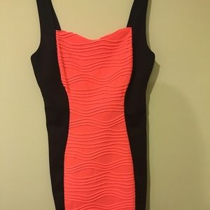 Neon orange and black bodycon dress size M